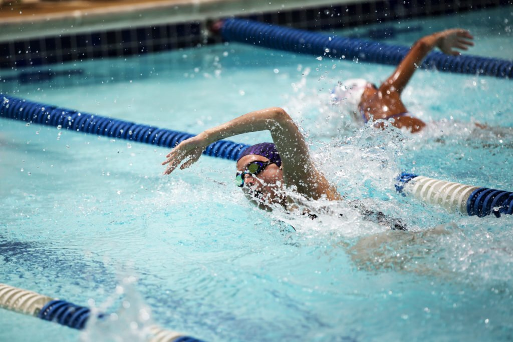 High school girl racing in a swim competition